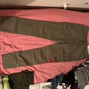 Army green pants with pink floral side print